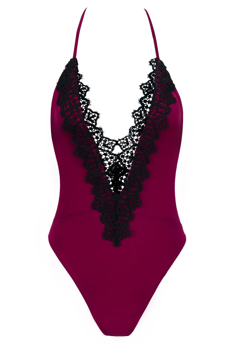 BLUE LIFE Eclipse One Piece - Black Dahlia One Piece   Black Dahlia  Blue Life Eclipse One Piece Magenta one piece with black lace trim along the deep plunging neckline. High cut leg. Adjustable criss cross spaghetti straps. Ruching on the back. Cheeky coverage.