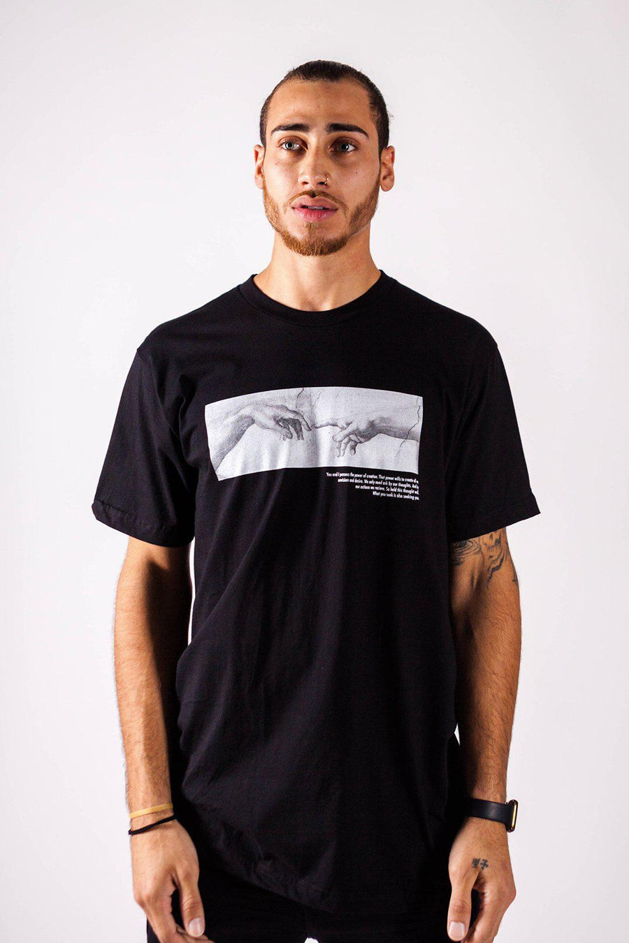 WHAT YOU SEEK IS SEEKING YOU TEE IN BLACK