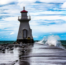 Load image into Gallery viewer, photo of lighthouse with waves crashing into it and seagulls around