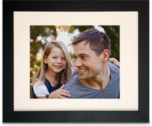 "Load image into Gallery viewer, 11"" x 14"" Black Framed Print photo of a young daughter on her father's back, both of them are smiling (landscape)"