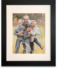 "Load image into Gallery viewer, 11"" x 14"" Black Framed Print photo of a three young boys laughing with their father holding them, all of them are smiling (portrait)"
