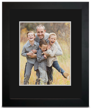 Load image into Gallery viewer, Black Framed Print photo of a three young boys laughing with their father holding them, all of them are smiling (portrait)