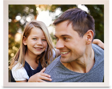 Load image into Gallery viewer, White Framed Print photo of a young daughter on her father's back, both of them are smiling (landscape)