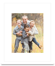 Load image into Gallery viewer, White Framed Print photo of a three young boys laughing with their father holding them, all of them are smiling (portrait)