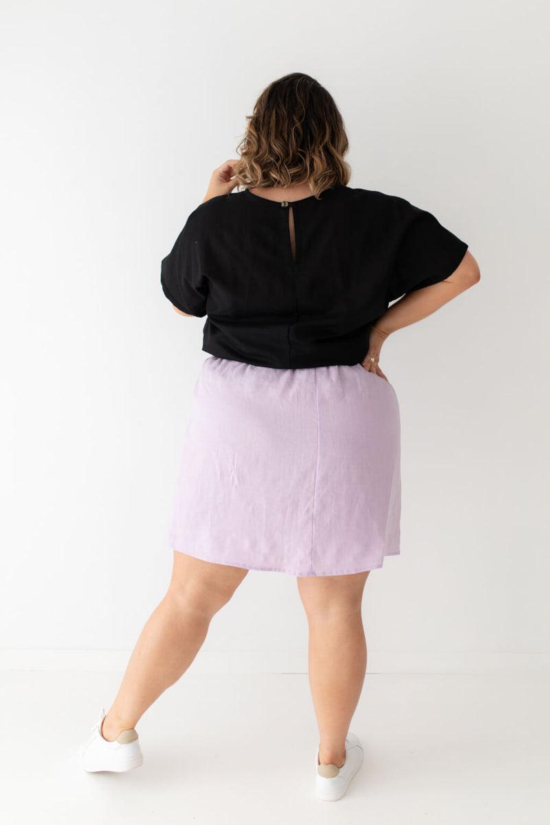 black top purple skirt linen