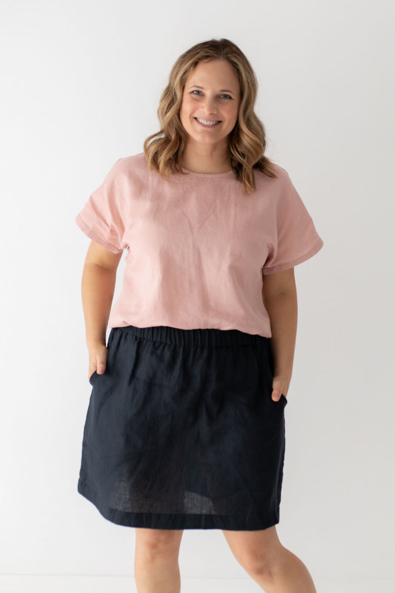 pink top navy skirt