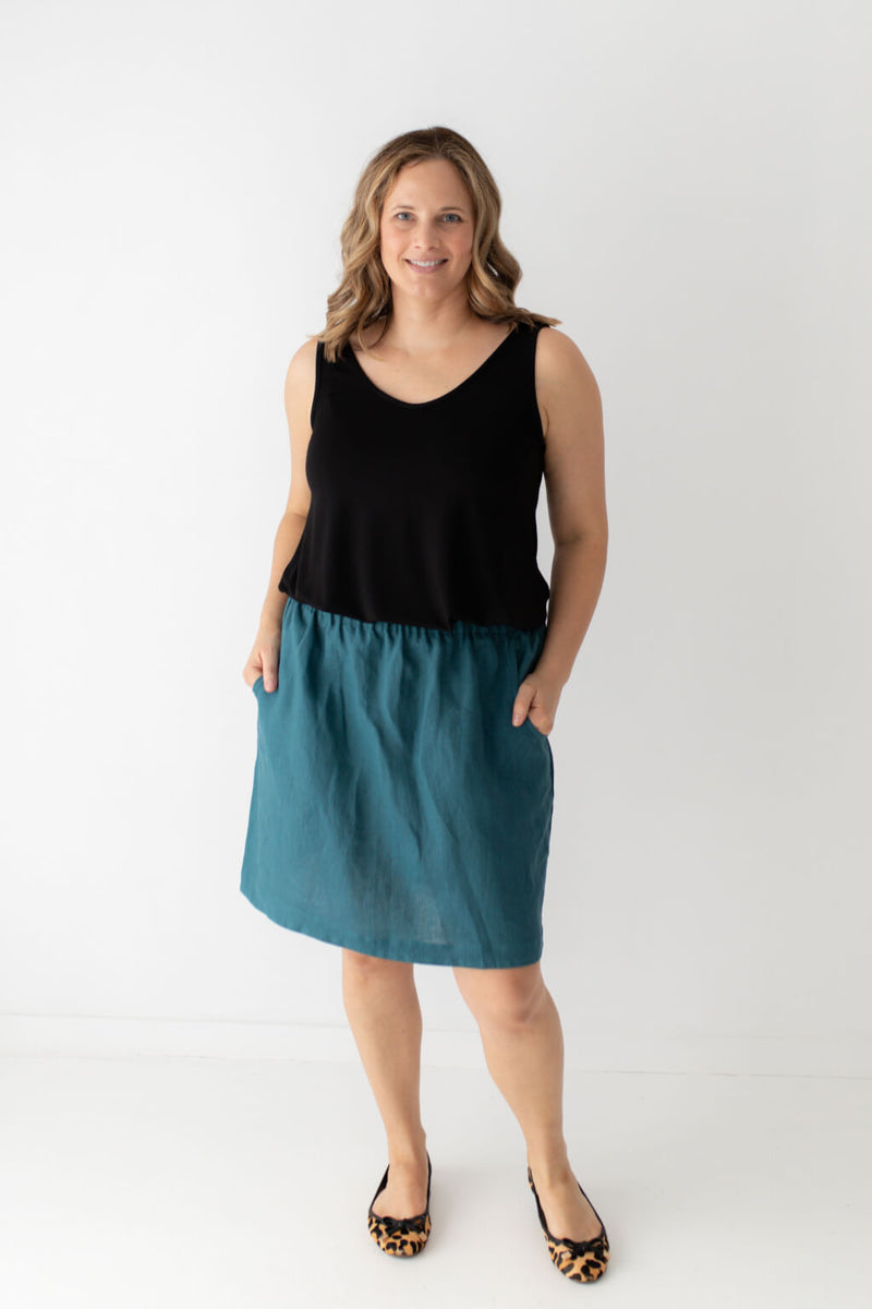 teal skirt black top