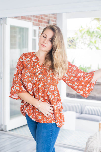red floral blouse top