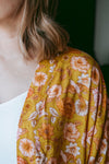 close up mustard floral bird print