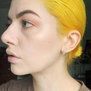Woman-with-yellow-hair-wearing-female-sign-earrings