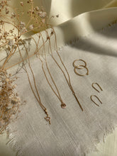 Load image into Gallery viewer, minimalist-gold-jewelry-layout-with-dried-flowers