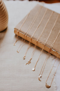 minimal-necklaces-laid-out-on-a-table