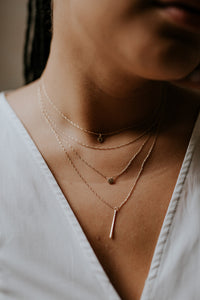 woman-wearing-14k-gold-layering-necklaces