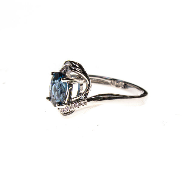 14KW London Blue Topaz Twist Bypass Ring