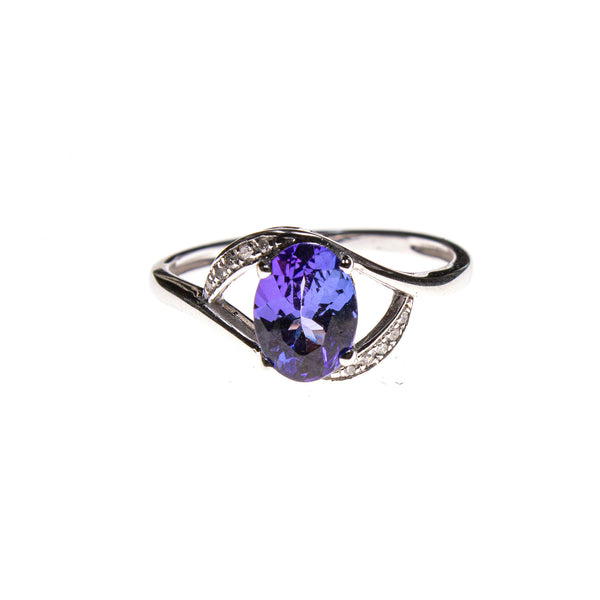 14KW Gold Cradled Tanzanite Oval Ring