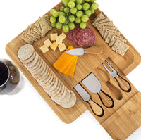 Dynamic Gear Bamboo Cheese Board Set with Cutlery in Slide-Out Drawer Including 4 Stainless Steel Serving Utensils - Perfect Charcuterie Board and Serving Tray for Entertaining or Gift Giving