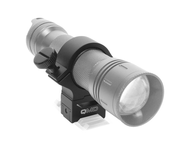 NM1 CL fitted into the Night Master QMD Quick Multi Directional Hunting Light Rail Mount