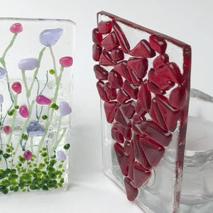 Quirky glass candle holders in a range of designs.