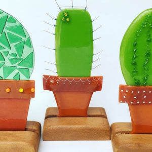 Quirky handmade fused glass stand-up art pieces in a variety of designs.