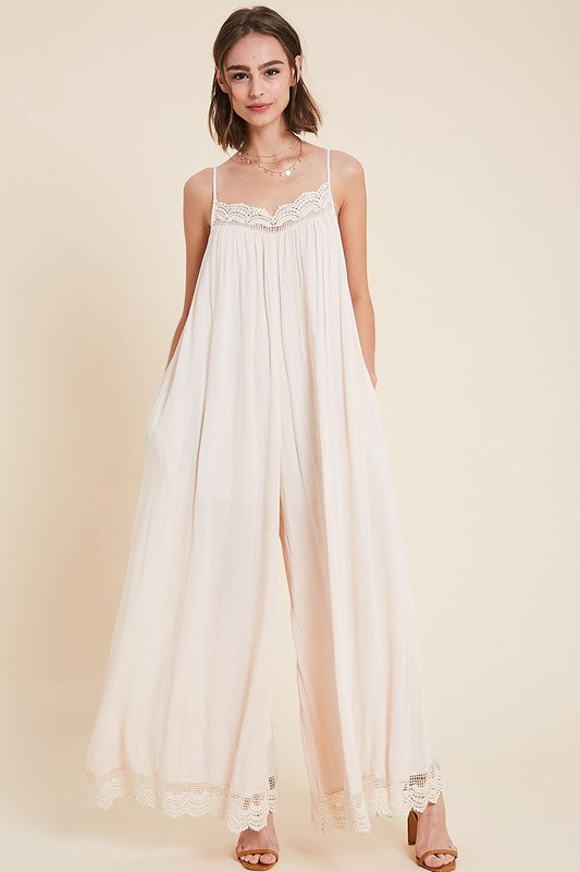 LACE TRIMMED WIDE LEG JUMPSUIT WITH POCKETS