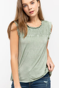 Sleeveless top with smocked chest design
