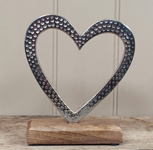 Hammered Heart On A Wooden Block