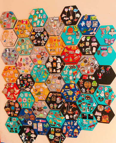 A pin board display using hexagon felt boards.