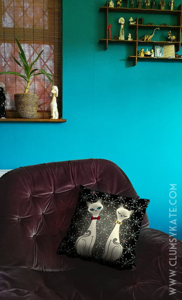 Atomic Cats in a mid century style black Cushion Pillow in Faux Suede by Clumsy Kate