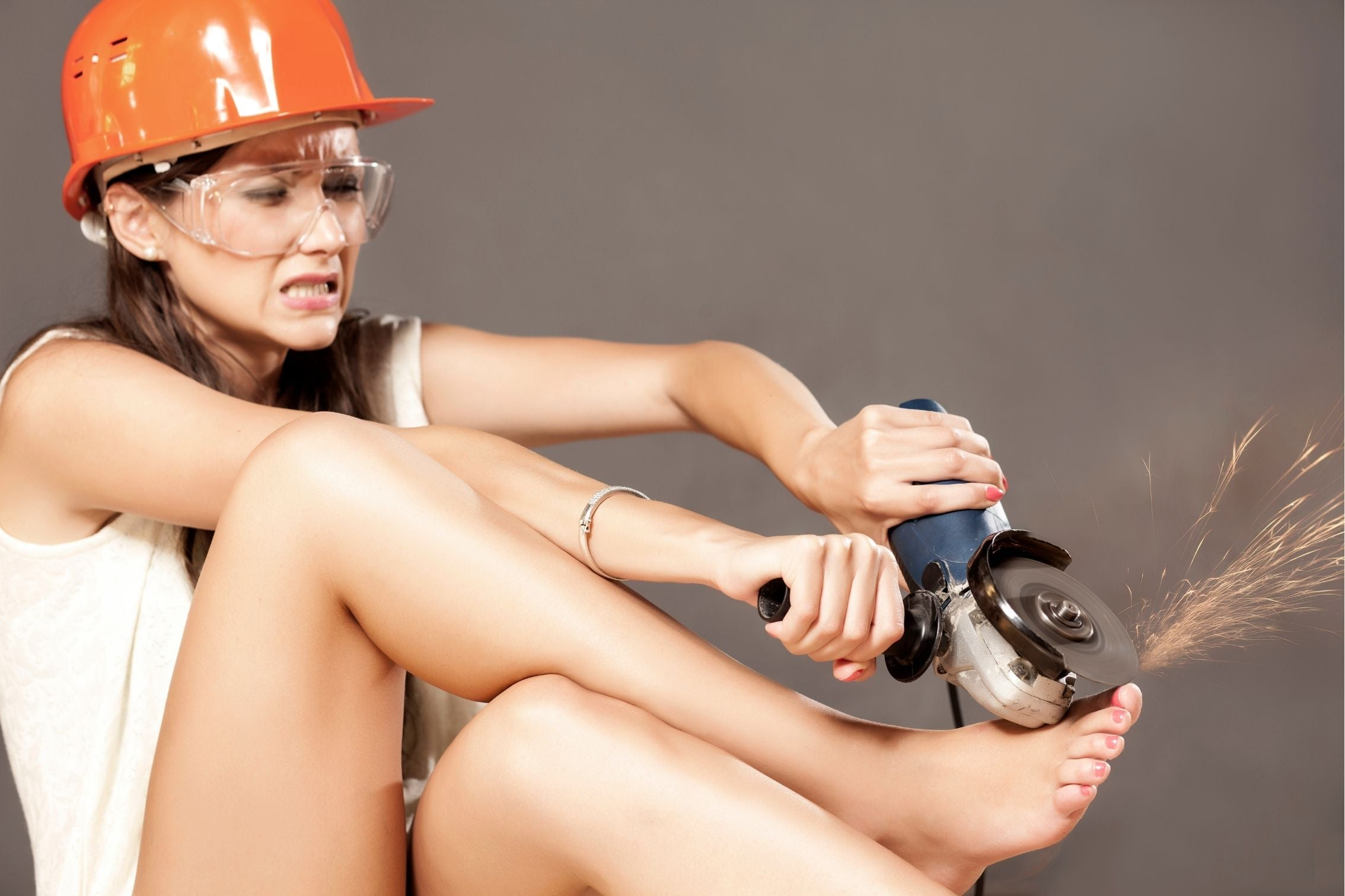 jokey image of a woman with disc grinder trying to trim her toenails