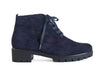 Side view of navy blue suede ankle boots with black chunky grippy sole and heel