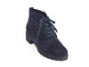 Overhead view of navy blue suede ankle boots with black chunky grippy sole and heel