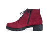 Side view of wine red nubuck suede ankle boots with black chunky grippy sole and heel