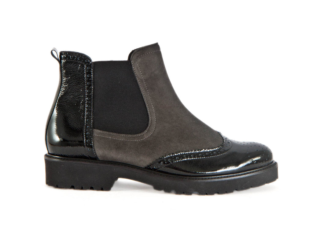 Brogue style ankle boot with patent black leather and taupe brown nubuck. Elasticated side and zip. Thick rubber sole.