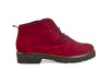Side view of ladies wine red suede brogue style ladies ankle boots with flat black heel and sole and skinny laces