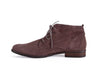 Side view of grey brown nubuck leather desert boot with wood effect flat heel and brogue style punched toe detail