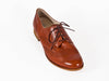 Overhead view of smart brown leather ladies brogue shoes with fine laces, flat heel and elegant punched leather detail