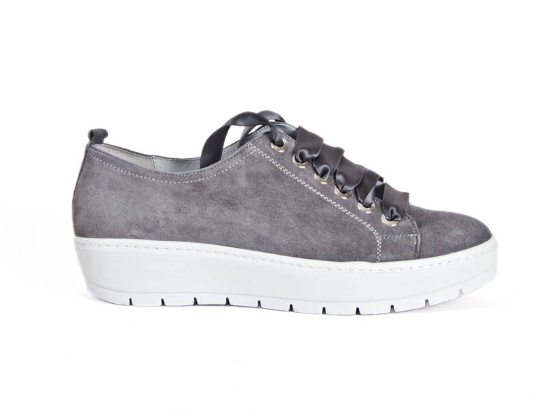 Side view of grey nubuck leather trainers with feature ribbon laces and thick white non-slip soles - Ellie Dickins Shoes