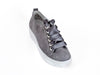 Overhead view of grey nubuck leather trainers with feature ribbon laces and thick white non-slip soles - Ellie Dickins Shoes