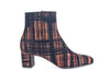 Ankle boot with heel in tartan fabric and leather