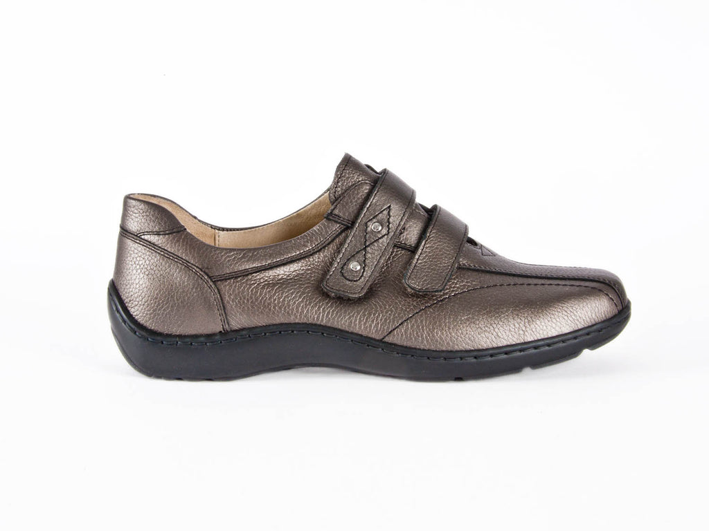 ladies flat metallic grey leather slip-on shoes with 2 adjustable straps across the top of the foot and a contrasting black rubber sole