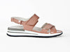 glossy pink leather strappy sandal with contrasting white rubber sole with grey detail and fine black tread