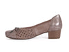 side of ladies court shoe with punched suede sides and top, with a contrasting texture patent leather heel and toe, in go-with-everything taupe