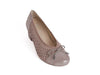 top view of ladies court shoe with punched suede sides and top, with a contrasting texture patent leather heel and toe, in go-with-everything taupe