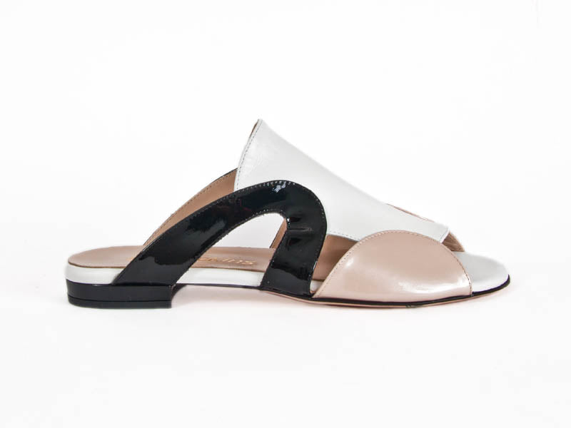 flat ladies sandal with a white top and nude and black sides, black heel and white leather lining - Ellie Dickins Shoes