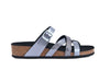 side view of Strappy silver sandals with a flat moulded footbed, and adjustable strap