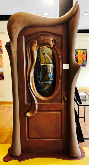 The Sculpted Door - Beautiful Woman Face Emerges from the Stained Glass Inset