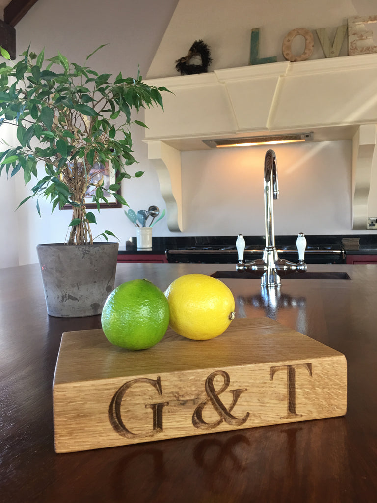 This is a chunky little board, made from solid oak. It is perfect for chopping fruit for G&T lovers or as a little cheese board. It looks beautiful displayed in your kitchen. Have it engraved with G&T on one side and like the standard one with LOVE on the other or have someone's name engraved on it.