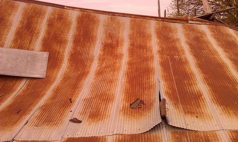 Reclaimed metal roofing panels