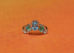 Tropical Spectrum wedding band or engagement ring in 14K white gold with reclaimed emeralds, diamonds and blue topaz