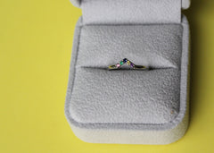 Dispersion 5 stone wedding band in 14K white gold with sapphires, emerald and amethyst